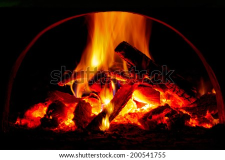 Hot flame of fire in oven - stock photo