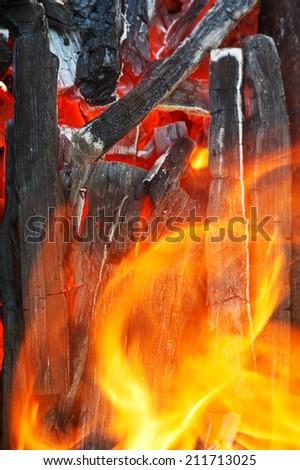 hot flame over burning wood close up - stock photo