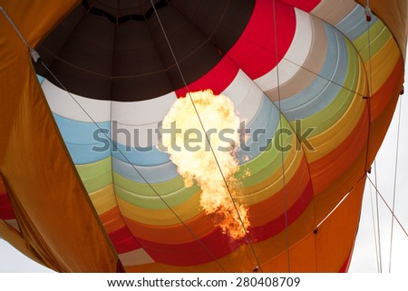 hot flame up the inside of hot air balloon  - stock photo