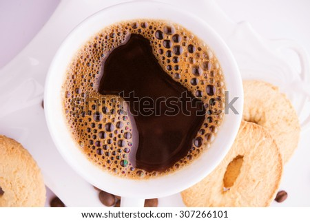 Hot fresh coffee with cookies - stock photo