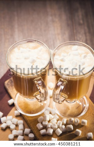 hot fresh coffee with white marshmallow in glass cup