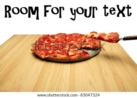 hot fresh pepperoni pizza with a slice being served to a hungry customer. isolated on white with room for your text - stock photo