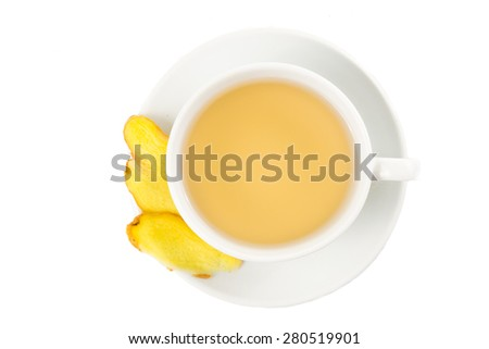 Hot ginger tea in a cup and saucer - stock photo