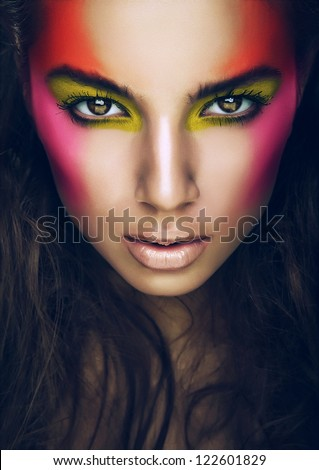 hot girl with eye shadows on face - stock photo