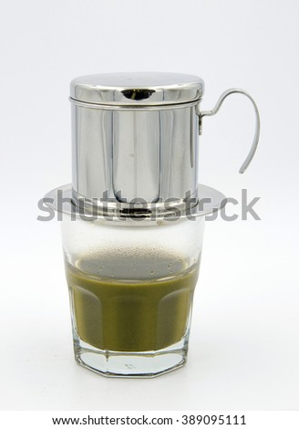 hot green tea in glass with aluminum filter on white background