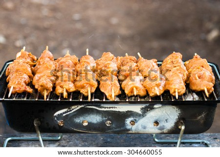 Hot grilling barbecue on grill - stock photo