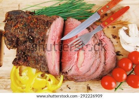 hot ham on wooden plate served over wood table - stock photo