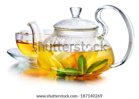 Hot herbal tea with ginger, lemon and mint.  Ginger beverage in transparent teapot. Healthy lemon tea - stock photo
