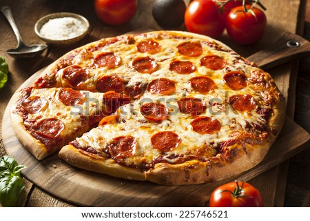 Hot Homemade Pepperoni Pizza Ready to Eat - stock photo
