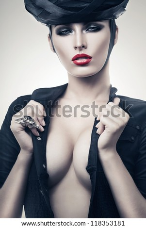 hot imperious woman in black with red lips - stock photo