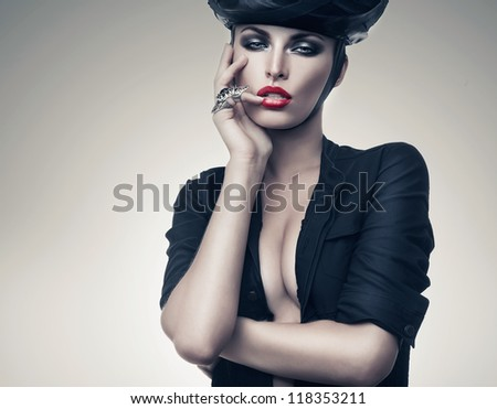hot imperious woman in black with ring - stock photo