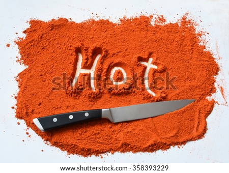 Hot in pepper with knife
