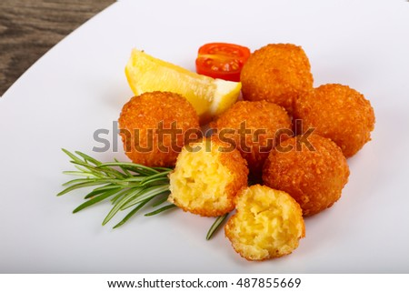 Hot juicy Cheese balls served rosemary branch