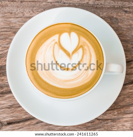 Hot late art on wooden backgroud - stock photo