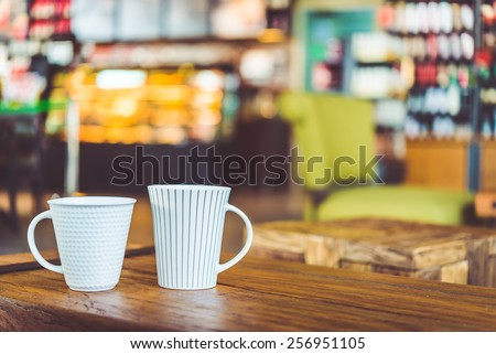 Hot latte Coffee cup on wooden table in coffee shop - vintage effect style pictures - stock photo