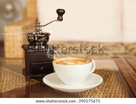 hot latte coffee in coffee cafe,Coffee cup on table in coffee cafe . - stock photo