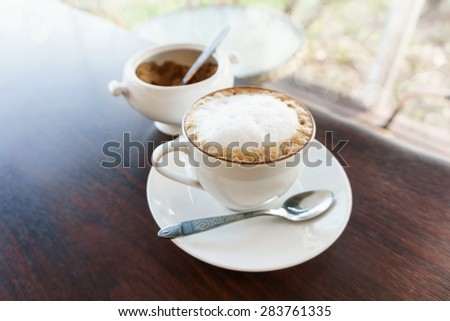 hot latte cup on table, white coffee mug