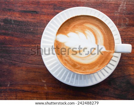 Hot Latte in the morning with very relax view will make your day - stock photo
