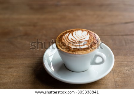 Hot Latte on a Wooden Table - stock photo