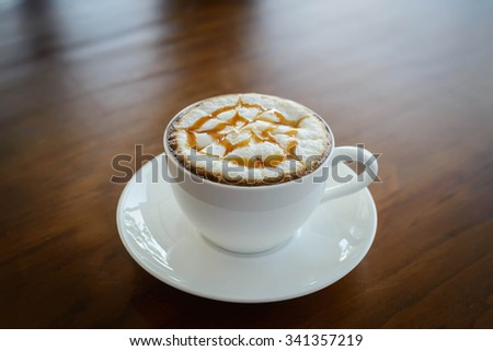 Hot latte on a wooden table