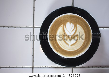 hot latte on white background - stock photo