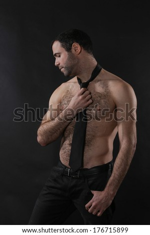 Hot Male Holding on to Tie - stock photo