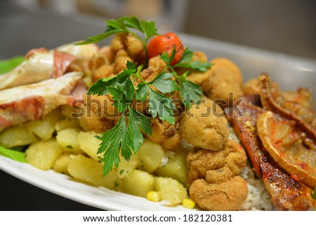 Hot meat dish with fried mushrooms, bacon, boiled potatoes and vegetables