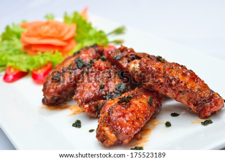 Hot Meat Dishes - Fried Chicken Wings with Curry Sauce  - stock photo