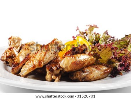 Hot Meat Dishes - Fried Chicken Wings with Orange Slice and Vegetable Leaf