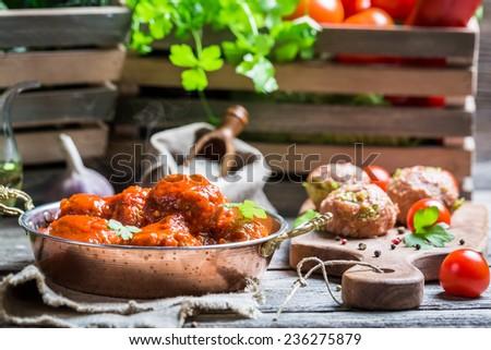 Hot meatballs with tomato sauce - stock photo