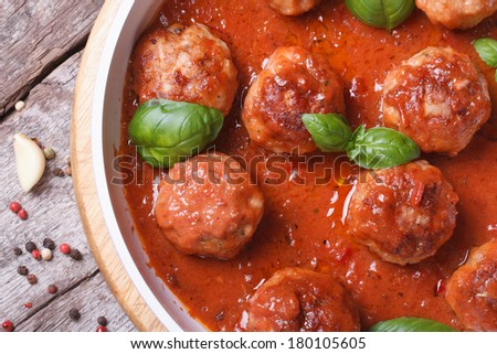 hot meatballs with tomato sauce and basil close-up. top view  - stock photo