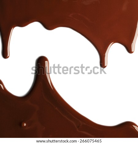 Hot melted chocolate pouring on the white background