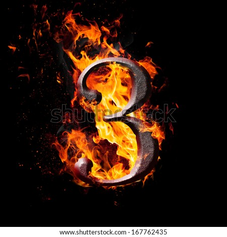 Hot metal burning numbers on black background - number three - stock photo