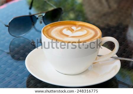 hot milk art coffee , shallow DOF - stock photo