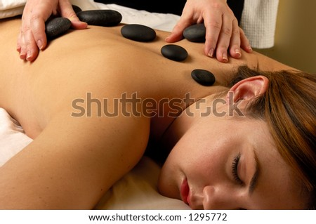 Hot Mineral Sacred Stone  Treatment Hands On Massage - stock photo