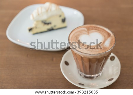 hot mocha coffee with cookies and cream cheese cake - stock photo