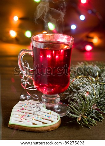 Hot mulled wine in cup, selective focus