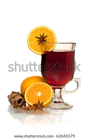 Hot mulled wine with oranges, anise and cinnamon. Isolated on white - stock photo