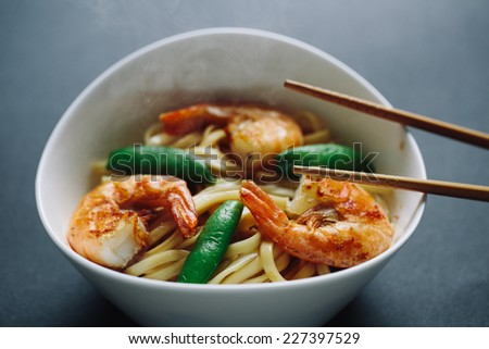hot noodles with shrimps on a black background - stock photo