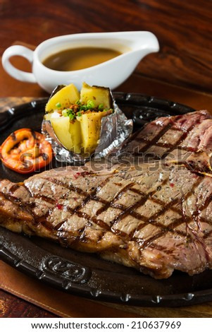 hot pan grilled beef T bone steak - stock photo