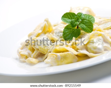 Hot pasta with cheese decorated with mint leaves... - stock photo