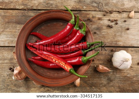 Hot peppers with spices on wooden table close up - stock photo