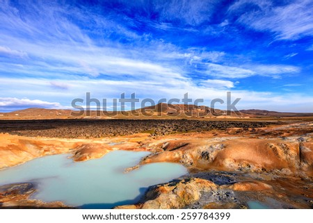 Hot pool at Krafla volcanic field in Iceland - stock photo