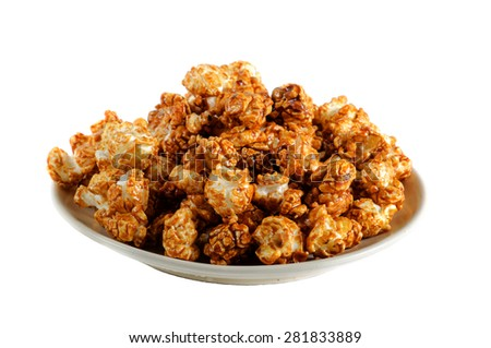 Hot popcorn with caramel in a bowl. Isolated on white background - stock photo