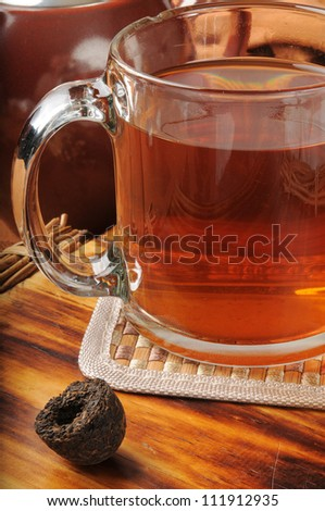 Hot Pu-erh tea with a pressed nest of the tea leaves