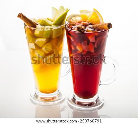 Hot red mulled wine, orange slice, anise and cinnamon sticks, close up. - stock photo