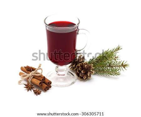 Hot red mulled wine with anise, cinnamon and pine cone sticks isolated on white background. - stock photo