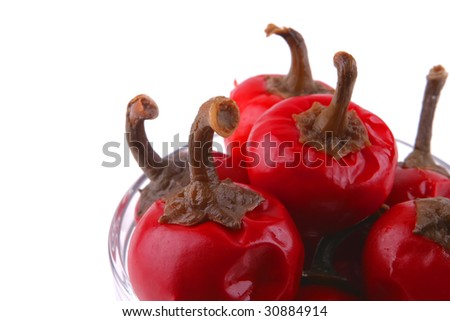 hot red small pepper with snakes over white