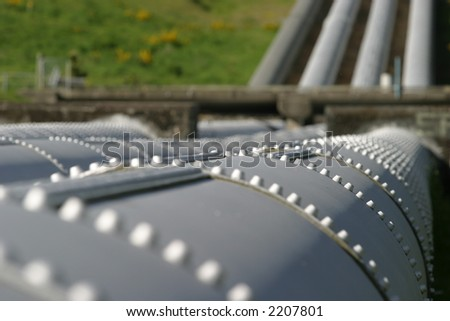 Hot-riveted steel penstocks at an old Hydro-electric power station, Lake Coleridge, Canterbury, New Zealand - stock photo