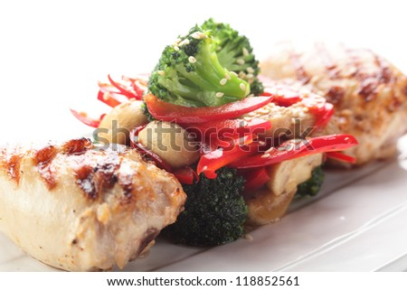 hot roasted chicken with pepper on white background
